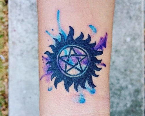 Blue anti-possession tattoo